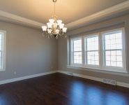 Dining room with hardwood floors and crown