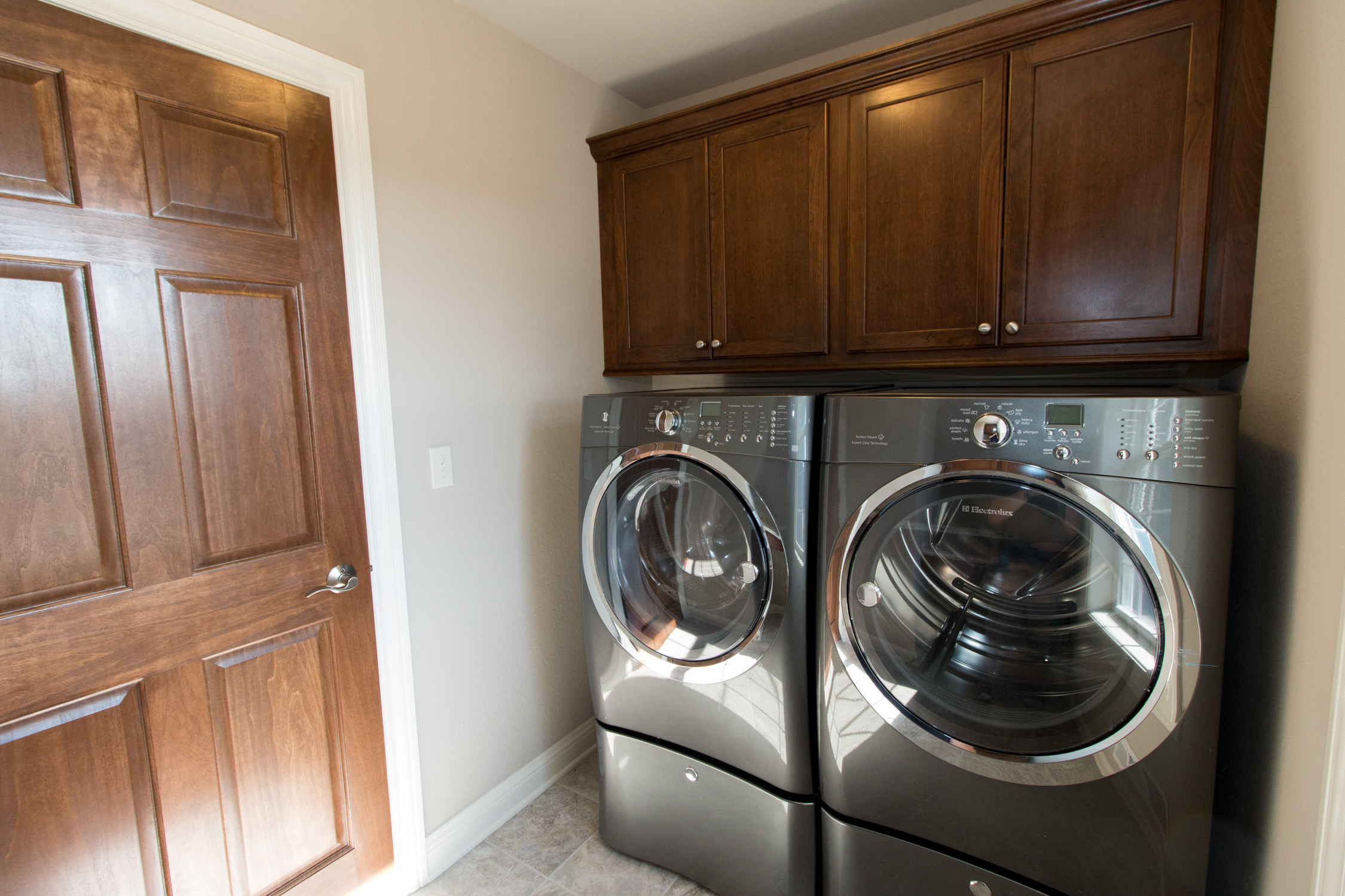 2nd Floor Laundry with front loading washer and dryer