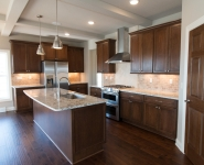 The Cattail - Kitchen with stained cabinetry