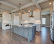Cattail - Kitchen with white cabinetry and stained island